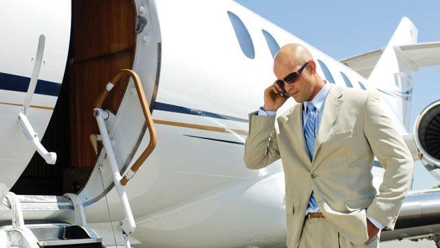airplane-private-jet-businessman-phone